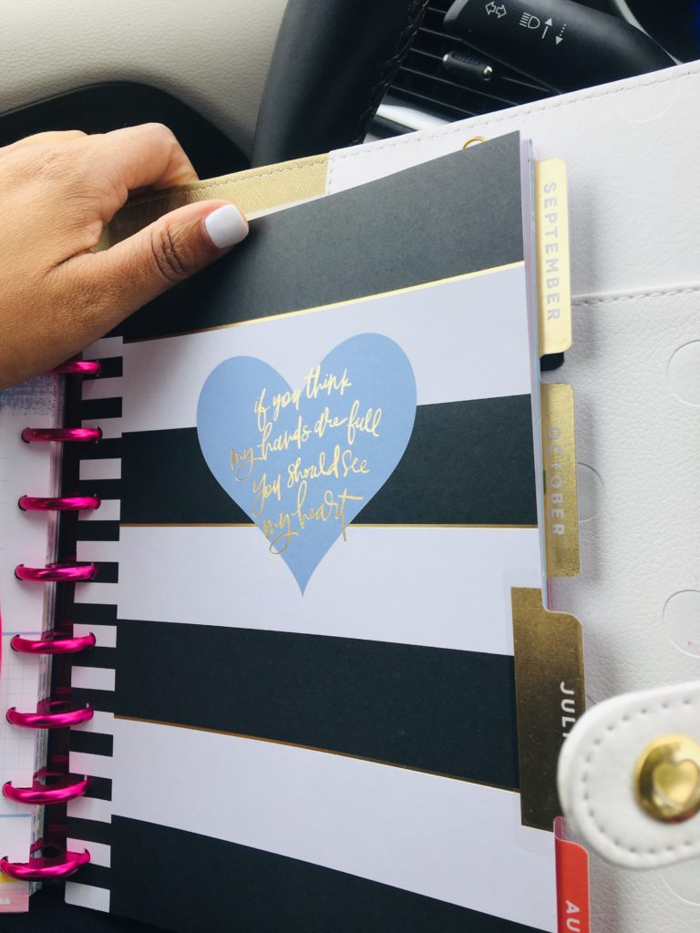 happy planner in car with a hand